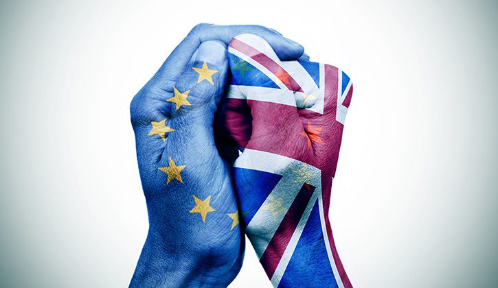Social Inequality & Brexit: A picture of a pair of hands, one painted with the european flag and one with the union flag.