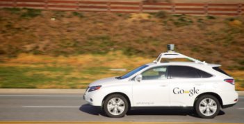A self-driving car from Google cruises the highway with a human minder. A group of scholars are calling for a new way of viewing innovation, from cars to energy sources. Photo: LoKan Sardari via Flickr